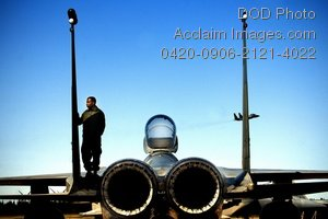 Clip Art Stock Photo of a Soldier Standing on a Jet