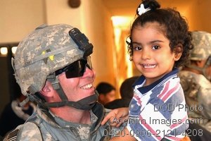 Clip Art Stock Photo of a Soldier Holding a Little Girl
