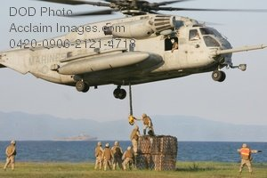 Clip Art Stock Photo of Soldiers Loading a Military Helicopter With Supplies