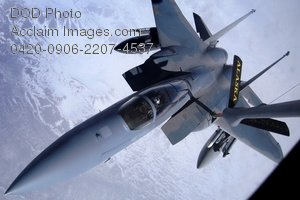 Clip Art Stock Photo of a Military Jet-F-15E Eagle Re-Fueling in the Sky