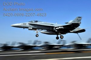 Clip Art Stock Photo of a Military Fighter Plane Landing on an Aircraft Carrier