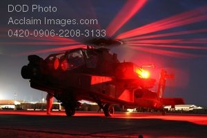 Clip Art Stock Photo of a Military Helicopter- Apache Longbow Preparing for a Night Mission