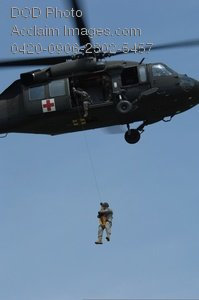 Free Public Domain Picture: Soldier Being Hoisted Into a Medical Helicopter
