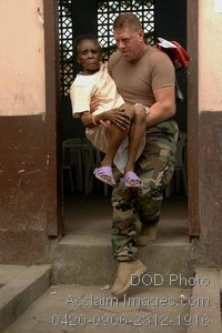 Free Public Domain Picture: American Navy Soldier Carrying a Sick Man To a Doctor In Colombia