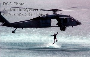 Free Public Domain Picture: Military Search and Rescue Soldier Jumping Into the Ocean From a Seahawk Helicopter