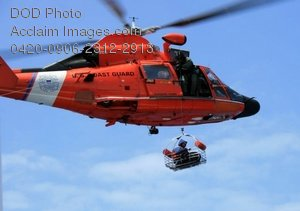 Free Public Domain Picture: Coast Guard Helicopter Dropping a Search and Rescue Member In a Basket