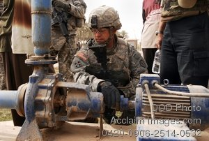 Free Public Domain Picture: US Army Soldier Inspecting a Water Pump In Iraq
