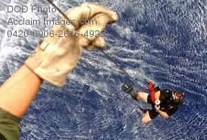 Free Public Domain Picture: Ariel View From a Seahawk Helicopter of a Sailor Dangling From a Rope Over the Ocean