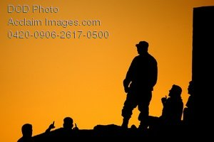 Free Public Domain Picture: Iraqi Air Force Soldiers Standing On Top of a Bunker at Sunset