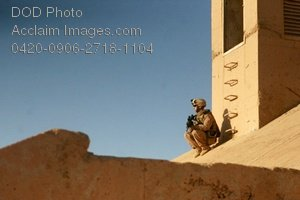 Free Public Domain Picture: Soldier Sitting on the Roof of a Building In Iraq