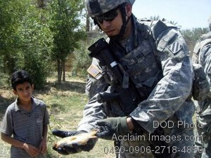 Free Public Domain Picture: Soldier Showing a Fish To an Iraqi Child