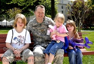 Free Public Domain Picture: Soldier, Wearing Fatigues, Sitting on a Bench With His Children
