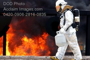 Free Public Domain Picture: Air Force Firefighter Training Crew Chief Setting a Practice Fire
