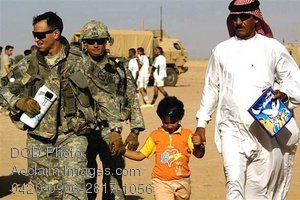 Free Public Domain Picture: US Military Soldiers and Iraqi Civilians Walking With a Child