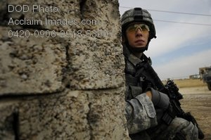 Free Public Domain Picture: U.S. Army Soldier Watching From the Corner of a Building-Iraq