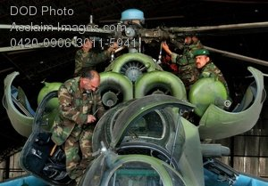 Free Public Domain Picture: Afghan National Army Air Corps Mechanics Doing Maintenance on an MI-35E Helicopter
