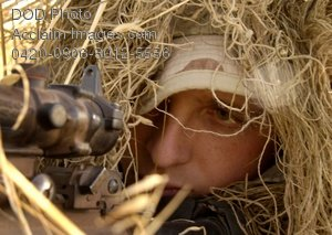 Free Public Domain Picture: Air Force Soldier Hiding In Straw As Camouflage With His Weapon