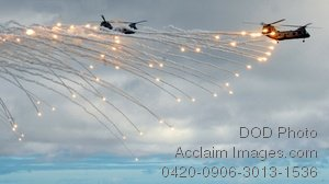 Free Public Domain Picture: CH-46E Sea Knight Helicopters Firing Flares In the Sky During an Air Power Demonstration