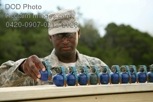 Free Public Domain Picture: African American Soldier Lining Up Simulated Hand Genades For Training