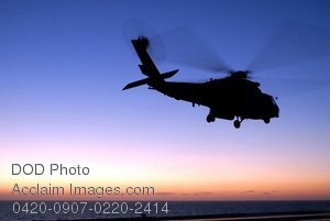 Free Public Domain Picture: SH-60F Seahawk Helicopter Lifting Off of the USS Ronald Reagan Aircraft Carrier at Sunset