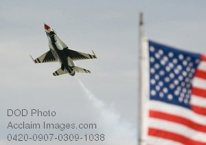 Free Public Domain Picture: Military Jet Flying Past American Flag