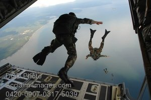 Stock Photo Clip Art of Paratroopers Jumping Out of a C-130J Hercules Aircraft