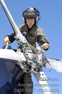 Free Public Domain Picture: Female Navy Pilot Performing a Pre-Flight Inspection on Her Helicopter