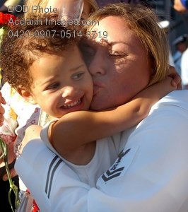 Free Public Domain Picture: Female Sailor Hugging Her Daughter at a Homecoming Celebration In San Diego CA