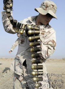 Free Public Domain Picture: U.S. Air Forceman Holding Up M-430 High Explosive Duel-Purpose Grenade Rounds