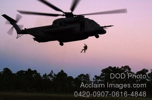 Free Public Domain Picture: Pararescueman Hanging From a Helicopter