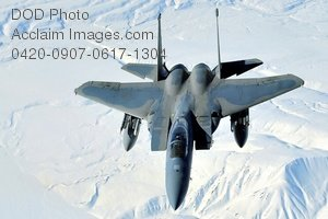 Free Public Domain Picture: F-15 Fighter Jet Flying Over Snowy Landscape