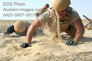 Free Public Domain Picture: U.S. Airman Low Crawling Through Sand During Training Exercise
