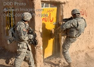 Free Public Domain Picture: U.S. Army Soldiers Kicking In a Door During a Combat Mission