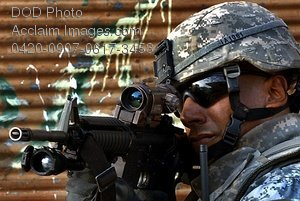 Free Public Domain Picture: Soldier Scanning a Street In Iraq Through His Weapon Scope