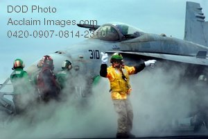 Free Public Domain Picture: Flight Crew Member Giving the Signal To Launch a F/A=18C Hornet Jet