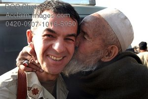 Free Public Domain Picture: Afghan Man Kisses a U.S. Navy Doctor In Appreciation For Relief Food