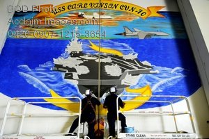 Free Public Domain Picture: Sailors Painting a Mural of the USS Carl Vinson on the Ships Hangar Bay Doors Photo