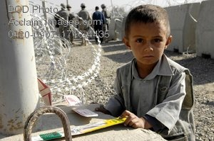 Free Public Domain Picture: Young Afghan Boy With a Toy Plane Photo