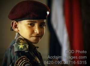 Free Public Domain Picture: Iraqi Boy Wearing Army Jacket and Beret Photo