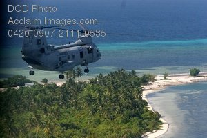 Free Public Domain Picture: Military Helicopter Flying Over an Island Photo