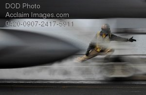 Free Public Domain Picture: Flight Crew Member Distorted By Jet Launching Photo