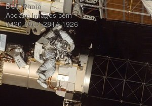 Free Public Domain Picture: Astronaut Repairing the Spacecraft In Space Photo