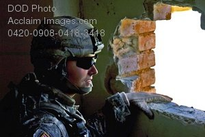 Free Public Domain Picture: Army Soldier Looking Through a Hole In the Wall at the Algehad Police Station Photo