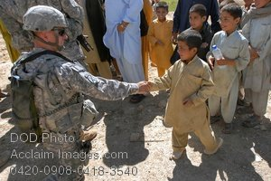 Free Public Domain Picture: American Soldier Shaking Hands With an Iraqi Boy Photo