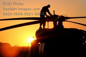 Free Public Domain Clip Art Picture: American Soldier Inspecting the Rotar of a UH-60 Black Hawk Helicopter Photo