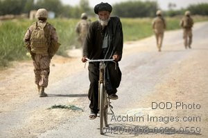 Free Public Domain Picture: U.S. Marines and Afghan National Army Soldiers Walking Past an Afghan Man on His Bike Photo