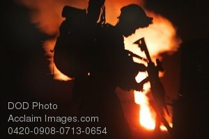 Free Public Domain Picture: Soldier Loading His Rifle, Warrior Silhouetted Against Flames Photo