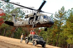 Free Public Domain Picture: Military Helicopter Carrying a Jeep Photo