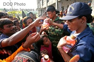 Free Public Domain Picture: Female Navy Doctor Passing Out Medication To People In Bangladesh Photo