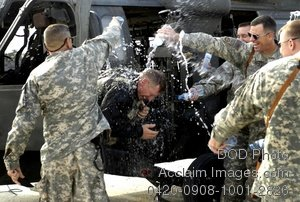 Free Clip Art Picture: Soldiers Spraying Water on an Officer in Celebration